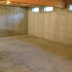 A cleaned out basement in Uniontown, shown before remodeling has begun