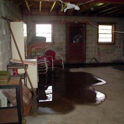 A flooded basement showing groundwater intrusion in Canton